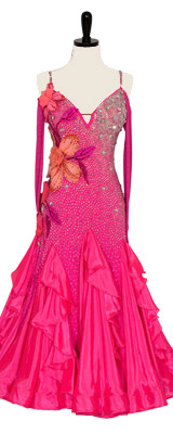 A photo of a floral Smooth ballroom dress by Doré. A hot pink dress with stunning floral appliqués.
