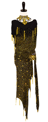This is a photo of our black dress with yellow (citrine) Swarovski stones and glass beading. This Rhythm Latin ballroom dress is by Vesa.