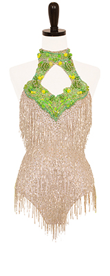 A photo of our Rhythm Latin ballroom dress Get the Party Started. White beaded fringe dress with lime green appliques.