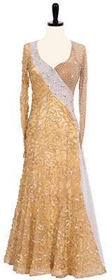 A photo of our gold Smooth ballroom dress, 24 Karat. This dress is dripping in gold!