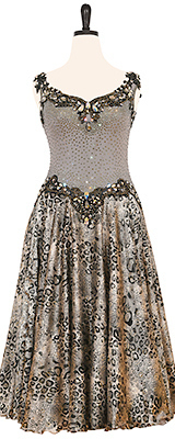 A photo of our animal print ballroom dress, Prowess. A silver and black ballroom dress with a jaguar print skirt.
