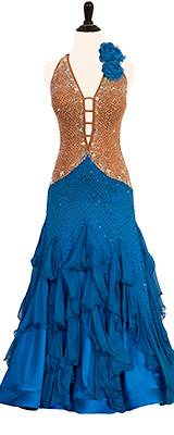 This is a photo of our ballroom costume by Doré, Selena. A gorgeous tan and blue Smooth ballroom dress decorated with Spanish Roses.
